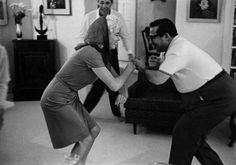 Marilyn dancing with Henry Weinstein during a party at Weinstein's house, January 1962. Photo by Arnold Newman.