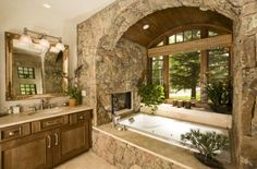 absolutely love all of the rocks around the tub and the wood on the ceiling and of course the awesome fireplace!