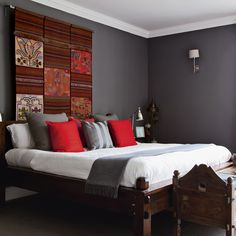Dark grey bedroom with patterned wall hanging