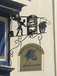 Le Marais, Boulangerie Malineau, 18 Rue Vieille du Temple, Paris Awesome ironwork showing a baker slippig dough into an oven! Paris 3, Paris Cafe, I Love Paris, Paris France, Storefront Signs, Cafe Sign, Pub Signs, Paris Travel, Signage