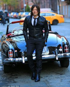 Suited and booted! Norman Reedus starred in a photo shoot in New York City's West Village on Monday