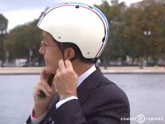 "Comedy Central's Stephen Colbert wearing a Nutcase Helmet in a fun video titled, ""Know Your District"" also features Nancy Pelosi Stephen Colbert, Comedy Central, Helmets, Finals, Knowing You, Tv, Celebrities, Movies, Hard Hats"