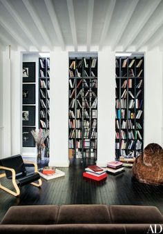 Tall bookcases designed by Locatelli line a living room wall | http://archdigest.com