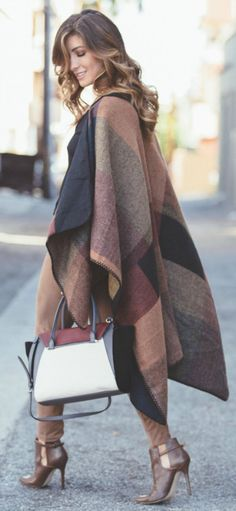 Wear your brown, black and burgundy coloured poncho over matching leggings and shoes. Via Deniz Selin  Satchel: Vince Camuto, Leggings/Poncho: Dynamite Clothing, Boots: Shoedazzle