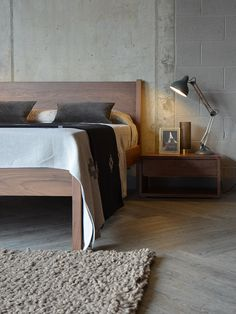 Walnut Zanskar bed with low walnut Black Lotus storage unit #interiordesign