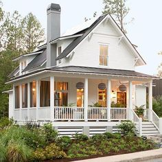 White facade House green exterior