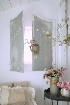 Beautiful shutter blends well with the gentle colours and pretty decor of this vintage chic room.