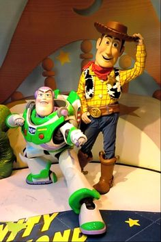"""The queue for Buzz and Woody at DHS has Stinky Pete's box, """"The Big One"""" that you can strap yourself onto, """"The Claw"""". Description from disboards.com. I searched for this on bing.com/images"""