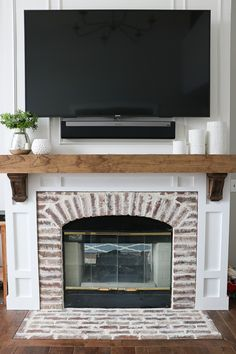 Updating an Old Fireplace - Progress Updating an old green builder basic fireplace to a vintage brick look using brick tile, simple moldings, and a stained wood rustic mantle with corbels. Wood Mantle Fireplace, Fireplace Update, Brick Fireplace Makeover, Farmhouse Fireplace, Living Room With Fireplace, Fireplace Surrounds, Fireplace Design, Rustic Mantle, Fireplace Ideas