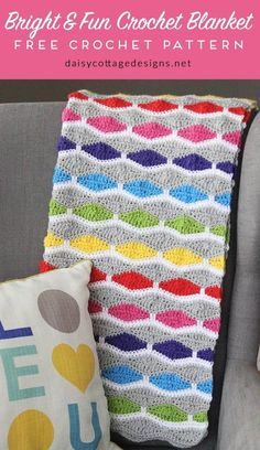 crochet blanket pattern   free crochet patterns   crochet afghan pattern   modern crochet pattern   Use this free crochet pattern from Daisy Cottage Designs to create this bright and fun afghan. Whether you're making a baby blanket for a friend or you just want a something to drape over your favorite chair, you'll love this crochet pattern. Instructions given to make this blanket in any size.