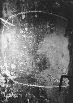 View of prisoner graffiti scratched on the walls of the Breendonck concentration camp