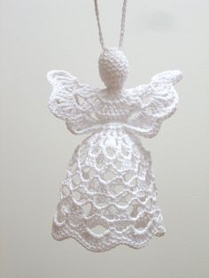 This white crochet angel is handmade from 100% cotton and MADE TO ORDER. It is about 11 cm tall and about 8,5 cm wide. Other colors of angel or ribbon are