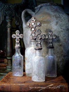 ❥ Vintage Cross Bottle -- Small Chandelier Remnant Cross on patina veiled antique bottle, Rustic Luxe Home Decor Altered Bottles, Antique Bottles, Vintage Bottles, Bottles And Jars, Perfume Bottles, Sign Of The Cross, Rustic Luxe, French Grey, Vintage Love