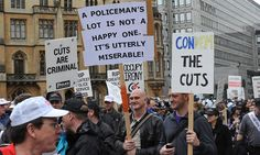 Police protest against cuts in London today.