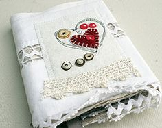 Great idea to use some appliqué, vintage trims and buttons for a journal cover.