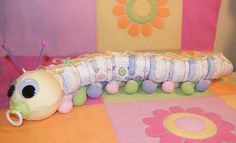 Learn to make a DIAPER CATERPILLAR from diapers and such. GR8 Baby Shower Gift. Diaper cake topper.
