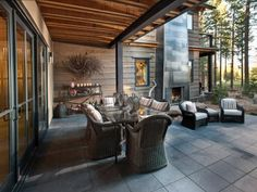 To create this unique partially covered outdoor dining space, architect David Bourke separated the home's two gabled spaces by a foyer. Slate tile flows from the foyer into this outdoor space.