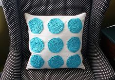 tutorial to make the flowers on this pillow.  would be cute on a little girls' shirt or dress.