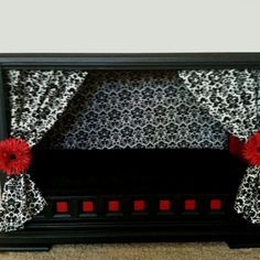 I turned an old TV console into a dog house.