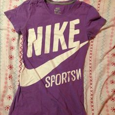 Nike slim fit t-shirt Used (that's why the purple is a little bit faded) but in good condition. It's fitted but the material is stretchy. Cute design Nike Tops Tees - Short Sleeve
