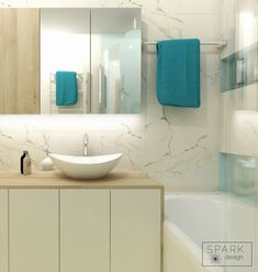 Mint & marble small bathroom with wooden elements.