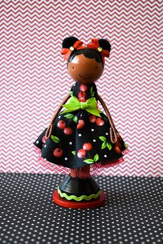 "Shawna Miniature Wooden Clothespin Doll-""Shawna"", a super cute wooden clothespin doll stands just over four inches tall, and is uniquely hand painted in vibrant colors and wears a real cotton fabric dress in a cherry print, with red tulle underskirting"