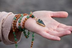 """Unleash your Wild Nature with this beautiful and unique - GREEN JADE and Rudraksha Seed Wild Mala - and its symbolic electroplated Green & White Jade arrowhead.  ---  Jade is a symbol of ♥ serenity and purity ♥ It signifies wisdom gathered in tranquility. It increases love and nurturing. A protective stone, Jade keeps the wearer from harm and brings harmony. Jade attracts good luck and friendship. Soothes the mind, releasing negative thoughts. Stimulates ideas. A """"dream stone"""", Jade brings…"""