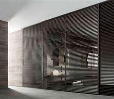 Rimadesio – Stripe Guiseppe Bavuso's Stripe sliding panel system in black aluminum by Rimadesio. Inside A House, Sliding Panels, Dressing Room Design, Japanese Interior, Home Room Design, Fireplace Wall, Closet Designs, Office Interior Design, Apartment Design