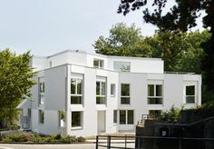 In parallel with a delicate ordering of its interiors, the exterior focus of this two-storey apartment building on the outskirts of Basel, Switzerland is its complex and playful render facade, writes Hugh Strange Basel, Contemporary Architecture, Townhouse, Multi Story Building, Exterior, Mansions, House Styles, Outdoor Decor, Facades