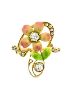 Art Nouveau enamel and diamond ring. Flower style enamel ring set with two main round old cut diamonds with an approximate weight of 0.40ct to centre of flower and below the stem. With a free form carved diamond set surround, set with eighteen rose cut diamonds, with an approximate weight of 0.20ct. Mounted and set in yellow gold, circa 1895.