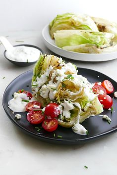 This is the best way to eat wedge salad! Searing the iceberg lettuce on the grill makes it tender and juicy, and the blue cheese dressing is irresistible. #wedgesalad #iceberg #grilling