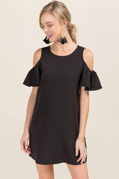 The Brittney Cold Shoulder Shift Dress features short ruffle sleeves and  stretch fabrication.