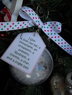 I Spy an Ornament!    Here's what you need to put one of these together:  Plastic Center-splitting ornament  Plastic Filler Pellets  8-10 Miniature Christmas Items  Ribbon  Paper Tag