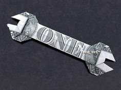 Hello,    Up for sale is a beautifully crafted origami Wrench. Its made with a brand new dollar bill.    It makes a great novel gift for that