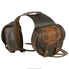Saddle bag Oklahoma... Double saddle bag, with double leather flap with tooled leather accent, has two internal leather ties for a more secure closure, bordered and edged with double stitching. It is water resistant as water-repellent leather is used in its construction, the accessories are top quality and customised. Dimensions: (bag ) ca. 19 x 16 x 7 cm... DON'T let yourself be fooled by the manufacturer's description. The flap isn't tooled at all. It's embossed!