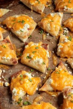 Feta Cheddar Naan Bites - hese Feta Cheddar Naan Bites were inspired by favorite sandwich at the coffee shop below our apartment! It's a warm piece of naan topped with a garlic mayo and melted feta and cheddar cheese!