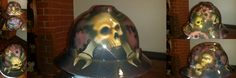 Custom hard hats and welding helmets by http://www.zimmerdesignz.com This one is skulls and gears. for a mechanic