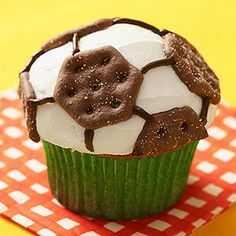 Top soccer party cupcakes with Oreo's 100-calorie cookies. birthday-parties