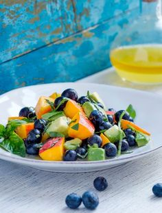 This Blueberry Peach and Avocado Salad is all your fave summer flavors tossed together for an easy to make (like weeknight easy) salad that will break the boredom of your go-to everyday salad.