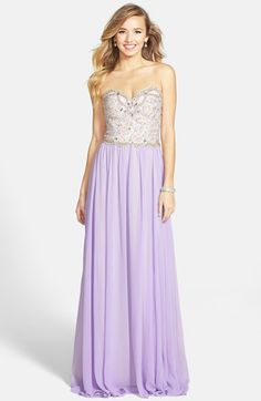 Free shipping and returns on Terani Couture Embellished Bodice Strapless Chiffon Gown at Nordstrom.com. Rich, luxurious embellishments create glamorous shine on the strapless sweetheart bodice of this majestic gown. Lilac chiffon falls from the waist into a sweeping skirt and a beautiful train.