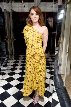 Emma Stone is darling in a yellow Gucci dress at a W Magazine event.