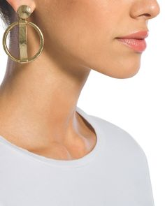 Give your look a modern edge with these cutout design drop earrings.