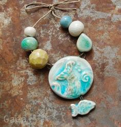 Mermaid Dream… These hand formed ceramic beads and pendant are hand glazed in an ocean of blues and greens by Gaea Cannaday.