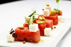 Salad with watermelon, feta cheese, olive, cucmber, pine nuts and affilla cress