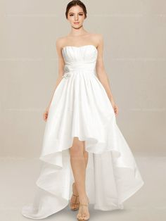 Casual wedding dress features in taffeta. Strapless high low mini ball gown with draped bodice. Sweep train. Hidden back zipper.