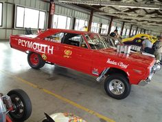 Red Plymouth drag car. Awesome!