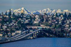 The I-90 floating bridge across Lake Washington, leading into the Mount Baker tunnel on the way to Seattle, Washington. Olympic mountains in the background.