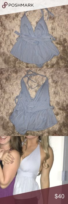 Free People Halter Top Super flattering v neck halter top! It has only been worn once and has an open back. Only selling cause it was too small around my chest. Free People Tops Blouses