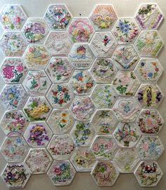 It's getting close to being finished! Here are all 46 hexies in their permanent position. Today I'm assembling the 6 half-hexies to finish out the top and bottom rows. As soon as they are embellished I will begin to hand stitch everything together. Only 3 weeks till the quilt show, deadline fast approaching! Made by Rhonda Dort.