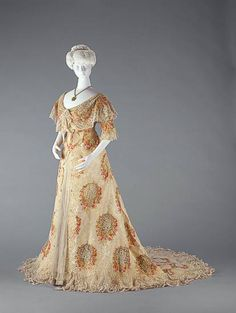 c1895 Formal dress in natural-colored silk taffeta with red flower design.